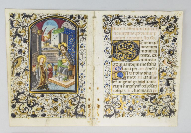TEXT FROM THE BEGINNING OF THE ADVENT HOURS OF THE VIRGIN. WITH A. DEMI-GRISAILLE MINIATURE DEPICTING THE CORONATION OF THE VIRGIN A VELLUM BIFOLIUM FROM A. BOOK OF HOURS IN LATIN.