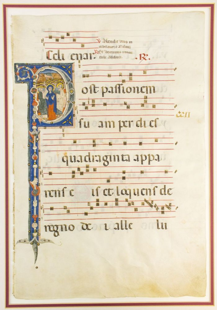 """WITH AN IMMENSE HISTORIATED """"P"""" DEPICTING THE ASCENSION OF CHRIST A LARGE VELLUM ILLUMINATED MANUSCRIPT LEAF FROM AN ANTIPHONARY IN LATIN."""
