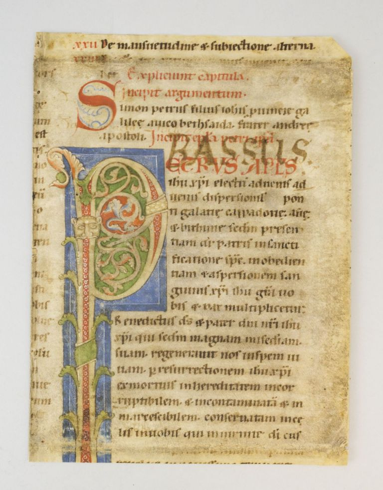 TEXT FROM THE FIRST EPISTLE OF SAINT PETER. WITH AN IMPRESSIVE DECORATED INITIAL A FRAGMENT FROM A. GIANT VELLUM BIBLE IN LATIN.