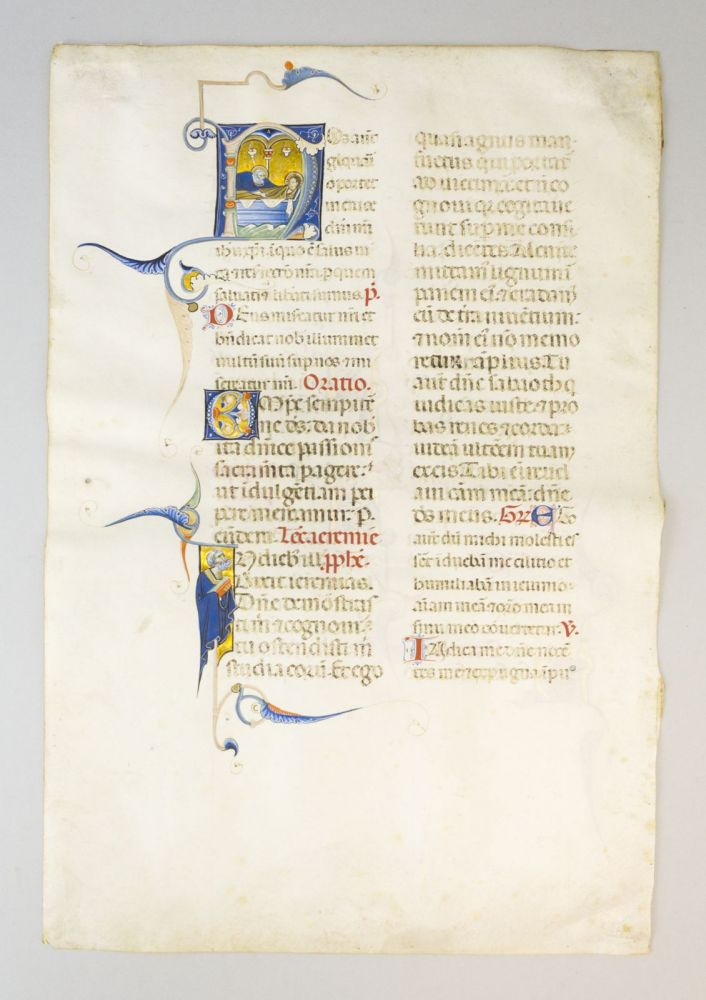 """TEXT BEGINNING WITH """"NOS AUTEM GLORIARI OPORTET. . ."""" WITH AN HISTORIATED INITIAL DEPICTING THE ENTOMBMENT OF CHRIST A VELLUM LEAF FROM A. LUXURIOUS MISSAL IN LATIN."""