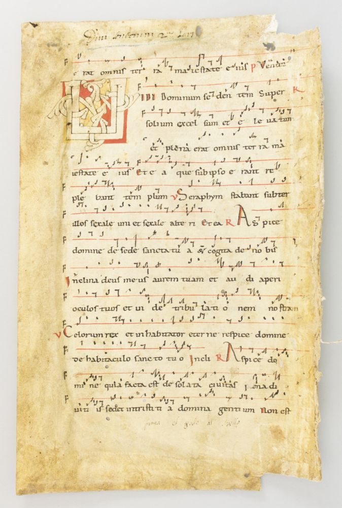 WITH A. FINE STRAPWORK INITIAL AN EARLY VELLUM MANUSCRIPT LEAF WITH NEUMES, FROM AN ANTIPHONER IN LATIN.