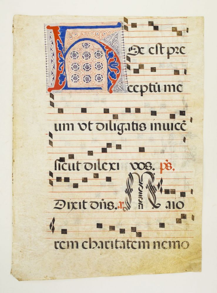 FROM AN ANTIPHONER IN LATIN. A VERY LARGE DECORATED VELLUM MANUSCRIPT LEAF WITH A. PROMINENT PUZZLE INITIAL.