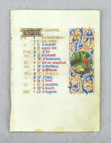 TEXT FOR NOVEMBER, WITH ILLUSTRATIONS FOR THE GATHERING OF ACORNS FOR PIGS AND SAGITTARIUS. DEPICTING THE LABOR OF THE MONTH AN ILLUMINATED VELLUM CALENDAR LEAF FROM A. BOOK OF HOURS.