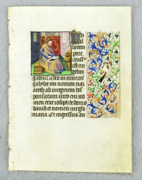 TEXT FROM GOSPEL LESSONS. FROM AN ENGAGING LITTLE BOOK OF HOURS IN LATIN AN ILLUMINATED VELLUM MANUSCRIPT LEAF WITH A. SMALL MINIATURE OF SAINT MARK.