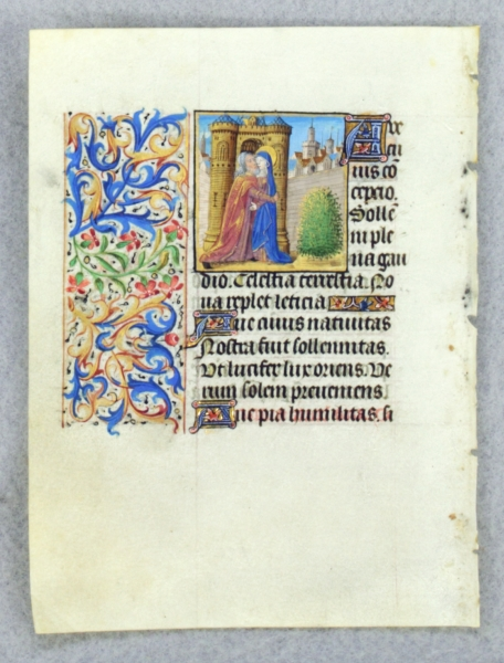 TEXT FROM THE SUFFRAGES OF THE SAINTS. FROM AN ENGAGING LITTLE BOOK OF HOURS IN LATIN AN ILLUMINATED VELLUM MANUSCRIPT LEAF WITH A. SMALL MINIATURE OF JOACHIM AND SAINT ANNE MEETING AT THE GOLDEN GATE.