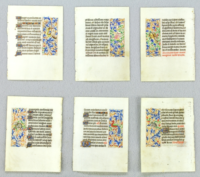 OFFERED INDIVIDUALLY ILLUMINATED VELLUM MANUSCRIPT LEAVES, ALL THE LEAVES WITH FINELY EXECUTED PANEL BORDERS FEATURING DELIGHTFUL ZOOMORPHIC INHABITATION, FROM AN ENGAGING LITTLE BOOK OF HOURS IN LATIN.