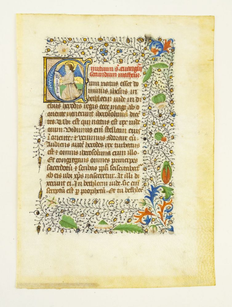 TEXT FROM THE OPENING OF THE GOSPEL SEQUENCES. FROM A. BOOK OF HOURS IN LATIN A LARGE ILLUMINATED VELLUM MANUSCRIPT LEAF WITH AN HISTORIATED INITIAL.