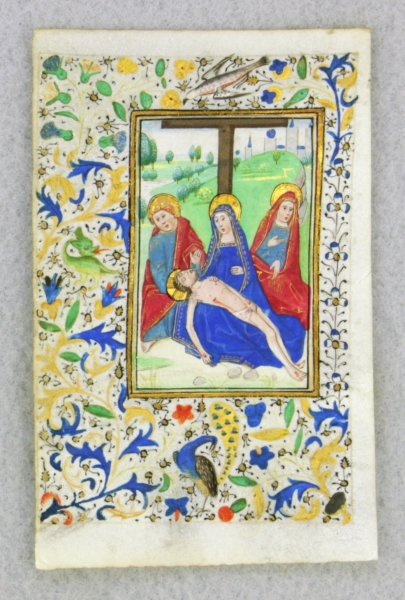 FROM A. BOOK OF HOURS IN LATIN A VERY SMALL ILLUMINATED VELLUM MANUSCRIPT LEAF WITH A. MINIATURE OF THE PIETÀ.