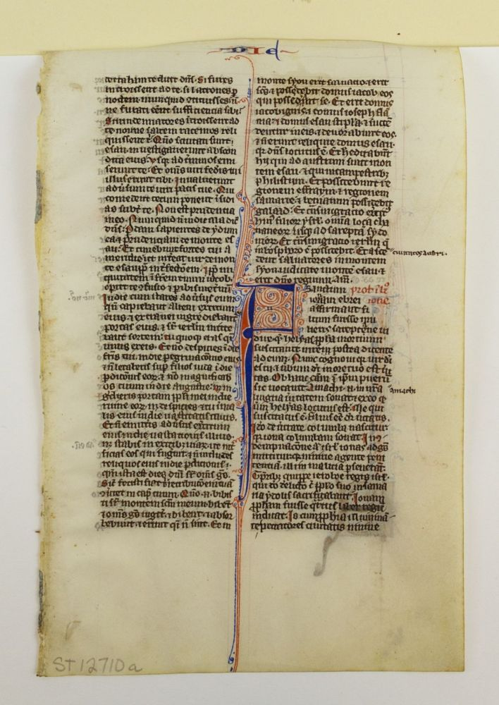 TEXT FROM THE OPENING OF THE BOOK OF JONAH. AN ILLUMINATED VELLUM MANUSCRIPT LEAF FROM AN ENGLISH POCKET BIBLE IN LATIN.