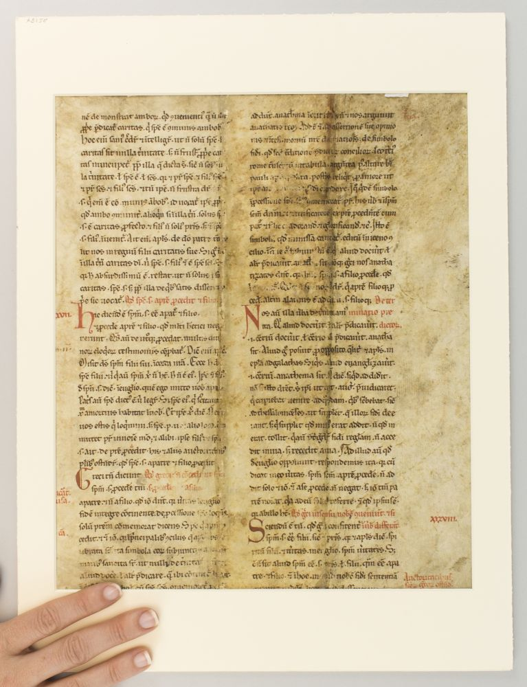 SENTENTIAE (BOOK I, PART OF DISTINCTIO XII). WITH MARGINAL GLOSSES MOST OF AN ILLUMINATED VELLUM LEAF FROM A. VERY EARLY MANUSCRIPT OF PETER LOMBARD.