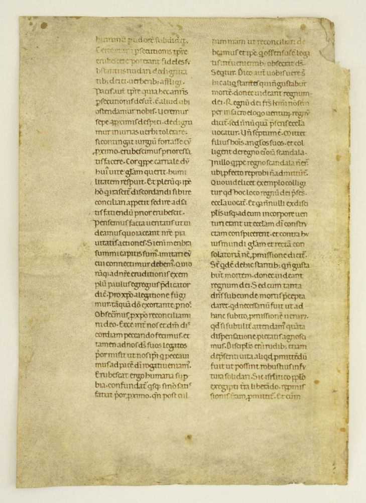 HOMILIAE IN EVANGELIAS, PART OF HOMILY XXXI. A LEAF FROM AN EARLY VELLUM MANUSCRIPT OF GREGORY THE GREAT IN LATIN.