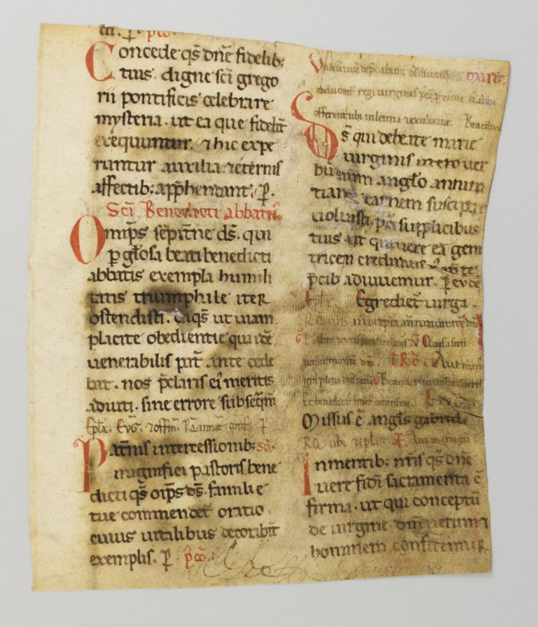 TEXT FROM THE SANCTORAL FOR MARCH AND APRIL, INCLUDING THE MASS OF SAINT BENEDICT. FRAGMENT OF A. VELLUM MANUSCRIPT LEAF FROM AN EARLY MISSAL IN LATIN.