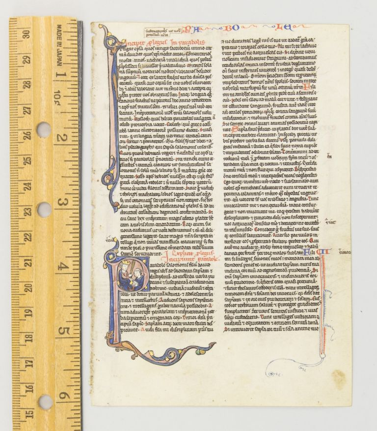 TEXT FROM THE OPENING OF PROVERBS. FROM A. PORTABLE BIBLE IN LATIN AN ILLUMINATED VELLUM MANUSCRIPT LEAF WITH AN HISTORIATED INITIAL.