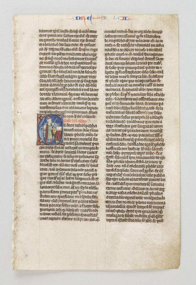 TEXT FROM II EZRA. FROM A. BIBLE IN LATIN AN ILLUMINATED VELLUM MANUSCRIPT LEAF WITH AN HISTORIATED INITIAL.