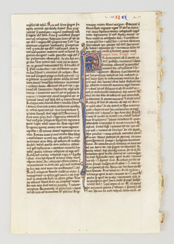 TEXT FROM THIRD AND FOURTH BOOK OF KINGS. FROM A. PORTABLE BIBLE IN LATIN AN ILLUMINATED VELLUM MANUSCRIPT LEAF WITH AN HISTORIATED INITIAL.