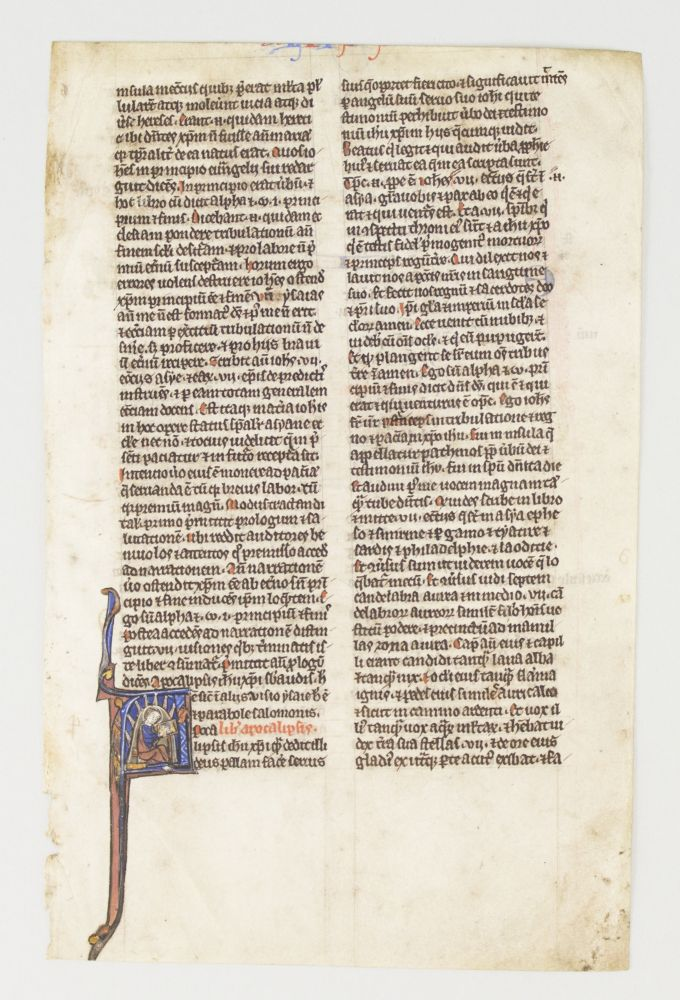 TEXT FROM REVELATION. FROM A. BIBLE IN LATIN AN ILLUMINATED VELLUM MANUSCRIPT LEAF WITH AN HISTORIATED INITIAL.