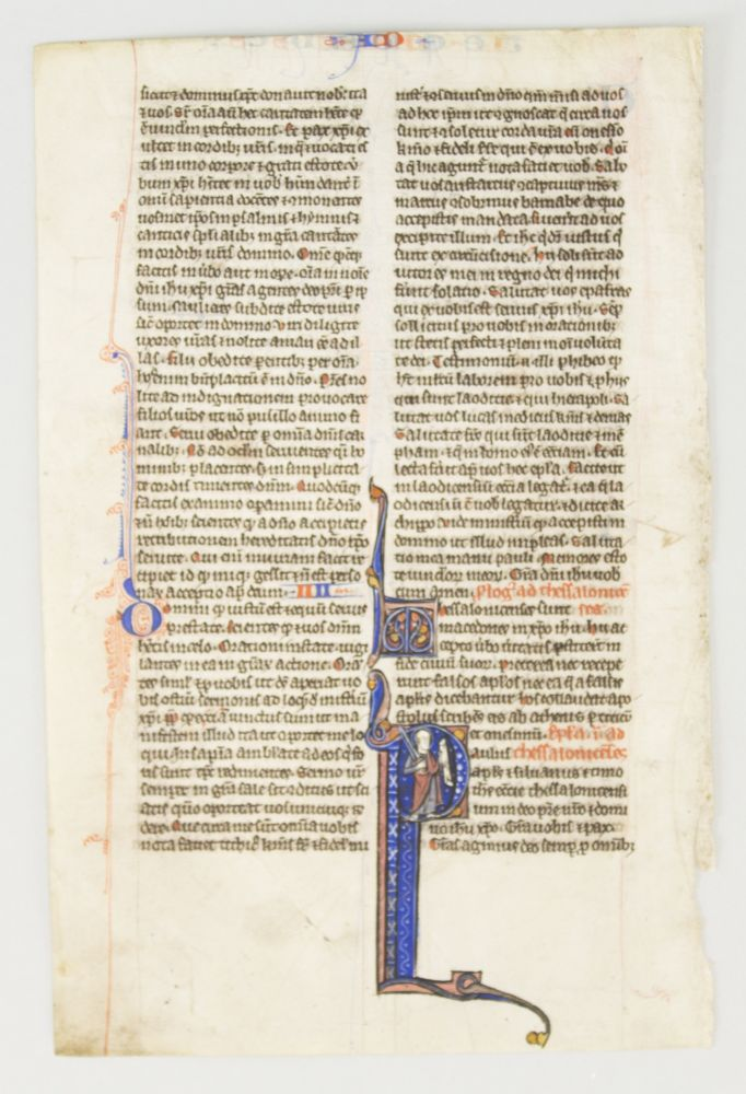 TEXT FROM THE OPENING OF THESSALONIANS. FROM A. BIBLE IN LATIN AN ILLUMINATED VELLUM MANUSCRIPT LEAF WITH AN HISTORIATED INITIAL.
