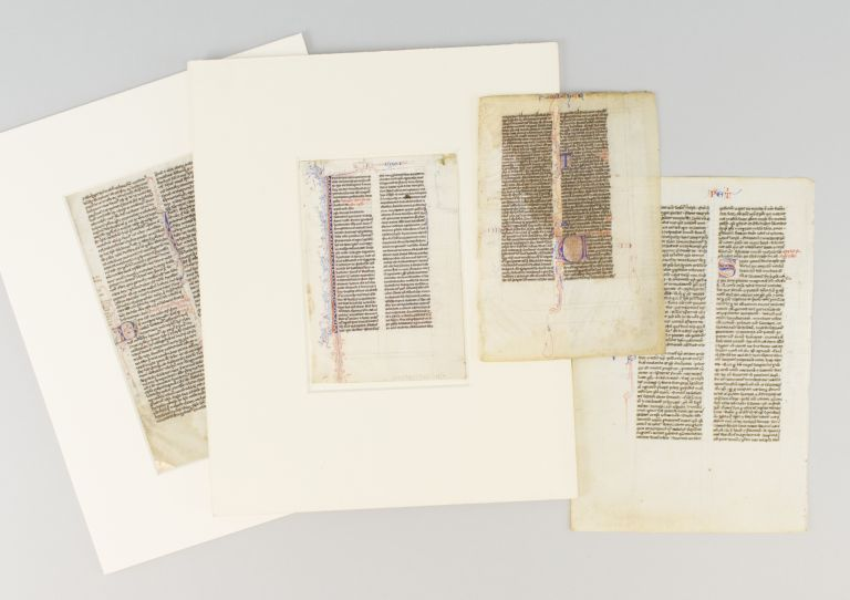 OFFERED AS A. GROUP FOUR VELLUM LEAVES WITH PUZZLE INITIALS FROM DIFFERENT POCKET BIBLES.