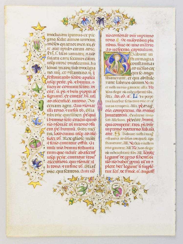 TEXT FROM THE SANCTORALE. AN ILLUMINATED MANUSCRIPT LEAF WITH TWO FINE HISTORIATED INITIALS FROM THE LLANGATTOCK BREVIARY IN LATIN.