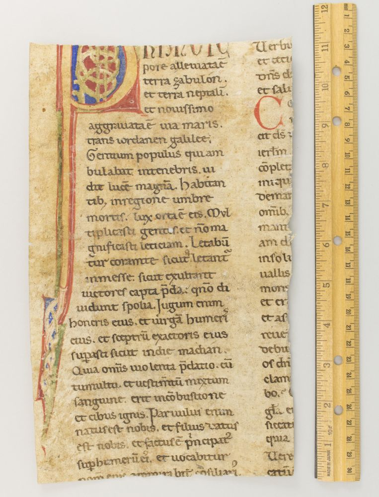 TEXT FROM 9 ISAIAH. WITH MOST OF A. LARGE INITIAL A. FRAGMENT OF A. DECORATED ATLANTIC BIBLE LEAF IN LATIN.