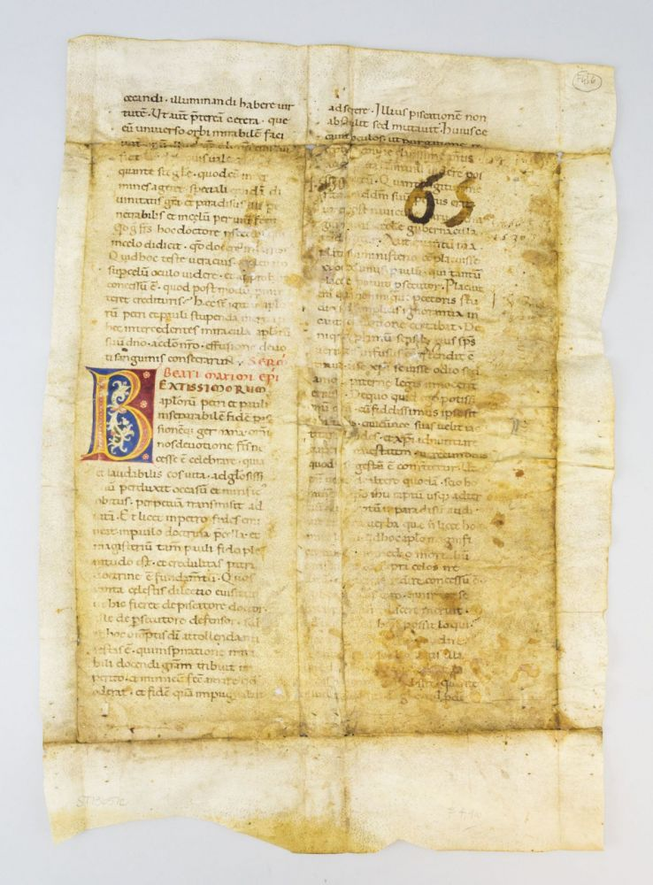 TEXT FROM THE SERMONS OF SAINT MAXIMUS. A LARGE VELLUM MANUSCRIPT LEAF WITH TWO COLORFUL INITIALS.