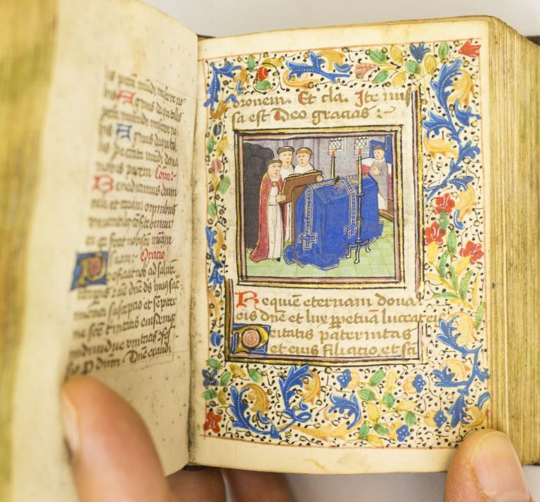 USE OF ROME. WITH CHARMING HISTORIATED INITIALS A MINIATURE ILLUMINATED MANUSCRIPT BOOK OF HOURS ON VELLUM IN LATIN AND DUTCH.