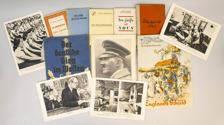 A COLLECTION OF ANTI-SEMITIC BOOKS AND POSTERS. WORLD WAR II, ANTI-SEMITISM.