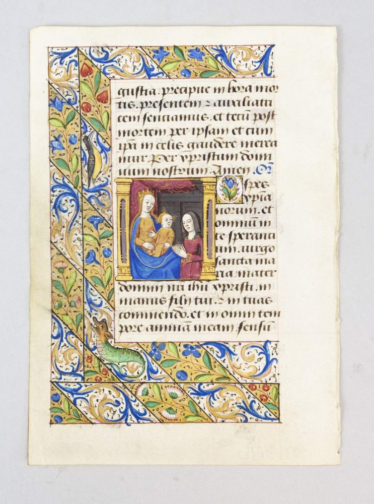 FROM A. BOOK OF HOURS IN LATIN AN ILLUMINATED MANUSCRIPT LEAF ON VELLUM WITH A. MINIATURE OF THE FEMALE PATRON KNEELING IN PRAYER.
