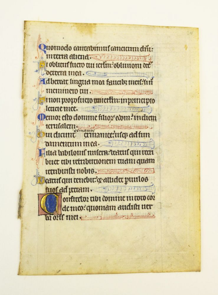 TEXT FROM PSALMS 136 AND 137. FROM A. PSALTER IN LATIN AN ILLUMINATED VELLUM MANUSCRIPT LEAF WITH IMMENSELY CHARMING ZOOMORPHIC LINE FILLERS.
