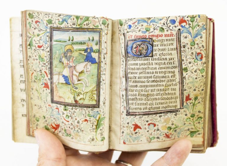 USE OF SARUM. PROFUSELY ILLUSTRATED WITH 20 MINIATURES AN ILLUMINATED BOOK OF HOURS ON VELLUM IN LATIN.