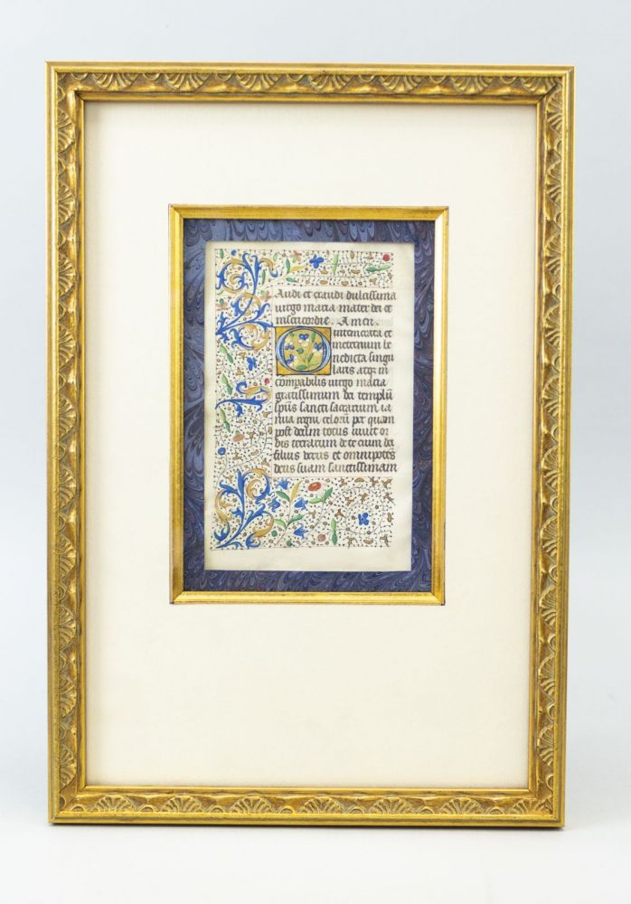 A HANDSOMELY FRAMED VELLUM ILLUMINATED MANUSCRIPT LEAF FROM A. BOOK OF HOURS IN LATIN.