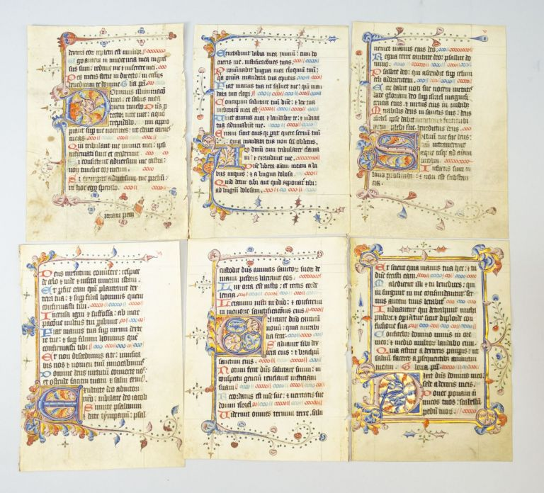 OFFERED INDIVIDUALLY ILLUMINATED VELLUM MANUSCRIPT LEAVES WITH EXUBERANT INITIALS AND BORDERS, FROM A. BOOK OF HOURS IN LATIN.