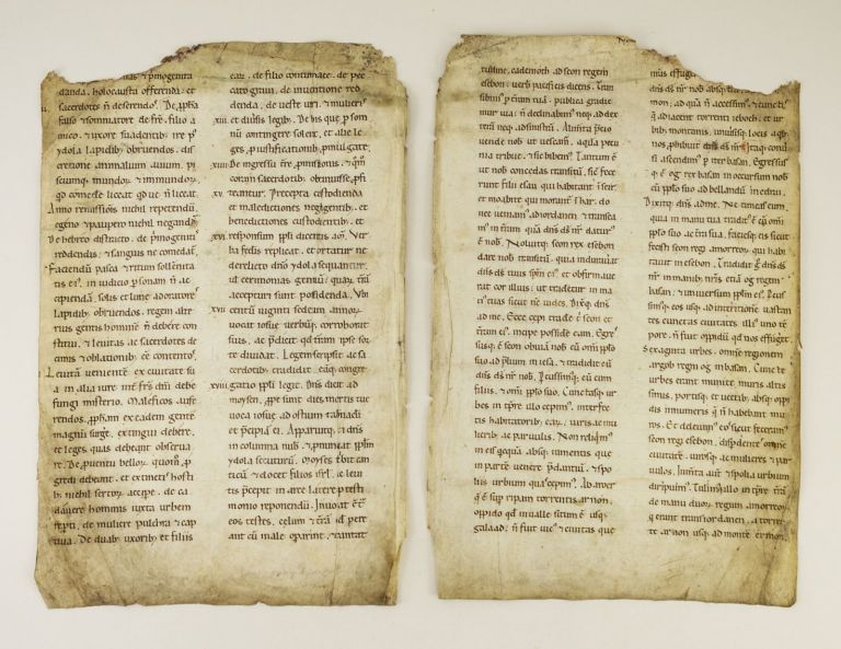 TEXTS FROM THE TABLE OF CONTENTS OF DEUTERONOMY AND FROM DEUTERONOMY 2:26-3:26. OFFERED INDIVIDUALLY TWO VELLUM MANUSCRIPT LEAVES, FROM A. LARGE BIBLE IN LATIN.