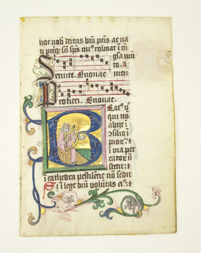 """WITH TEXT FROM PSALM 1 (""""BEATUS VIR""""). FROM A. PORTABLE GRADUAL IN LATIN AN ILLUMINATED VELLUM MANUSCRIPT LEAF WITH AN HISTORIATED INITIAL SHOWING KING DAVID WITH HIS HARP."""