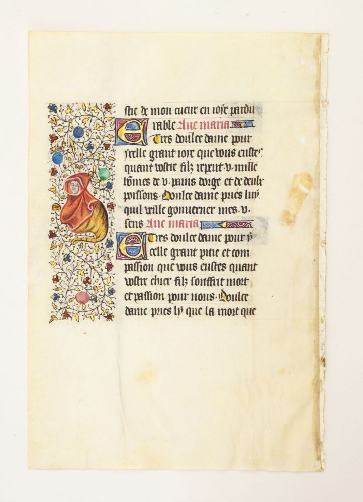 FROM A LARGE BOOK OF HOURS IN LATIN. A VELLUM MANUSCRIPT LEAF WITH ESPECIALLY CHARMING BORDER DECORATION.