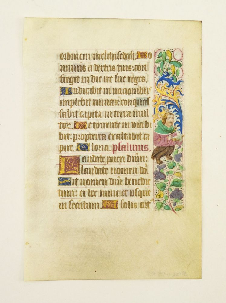 FROM A BOOK OF HOURS IN LATIN. AN ILLUMINATED VELLUM MANUSCRIPT LEAF WITH MARGINAL FIGURES.