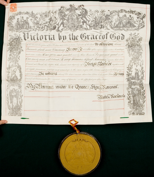A GRANT ON VELLUM, WITH ORIGINAL WAX SEAL IN ITS SKIPPET, APPOINTING HARRY THOMAS ALRED RAINALS KNIGHT BATCHELOR. DOCUMENT IN ENGLISH:.