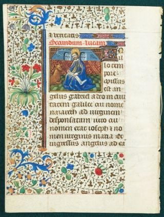 TEXT FROM GOSPEL LESSONS. FROM A. BOOK OF HOURS IN LATIN AN ILLUMINATED VELLUM MANUSCRIPT LEAF WITH A. SMALL MINIATURE OF SAINT LUKE.