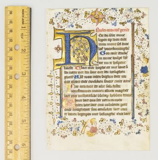 USE OF UTRECHT. TEXT FROM THE HOURS OF THE VIRGIN. FROM A. BOOK OF HOURS IN DUTCH AN ILLUMINATED VELLUM MANUSCRIPT LEAF WITH AN INHABITED BORDER AND A. LOVELY INITIAL.