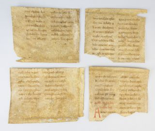 TEXT FROM MARK 13: 24-31; LUKE 1: 26-28; LUKE 3: 1-3; AND LUKE 7:21-25. OFFERED INDIVIDUALLY FOUR 11TH CENTURY VELLUM MANUSCRIPT FRAGMENTS FROM A. LECTIONARY.