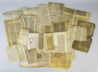 A. COLLECTION OF LEAVES ON VELLUM FROM MANUSCRIPTS OF VARIOUS WORKS ON CANON AND ROMAN LAW.