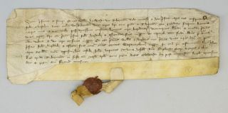 A 14TH CENTURY ENGLISH VELLUM DOCUMENT IN LATIN.