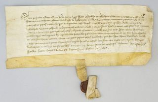 AN EARLY 15TH CENTURY ENGLISH VELLUM DOCUMENT IN LATIN.