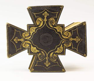 A SMALL ALBUM IN THE SHAPE OF A CROSS PATÉE.