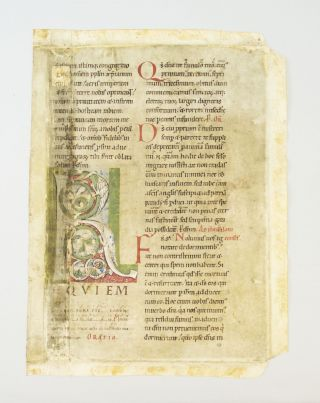 WITH AN IMPRESSIVE ROMANESQUE INITIAL COMPOSED OF INTERLACING DRAGONS A VELLUM MANUSCRIPT LEAF...
